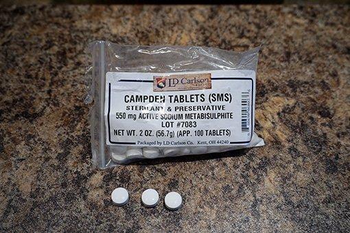 a bag of white campden tablets made of potassium metabisulfite
