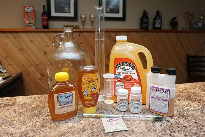 apple cider, honey and equipment for making a Cyser
