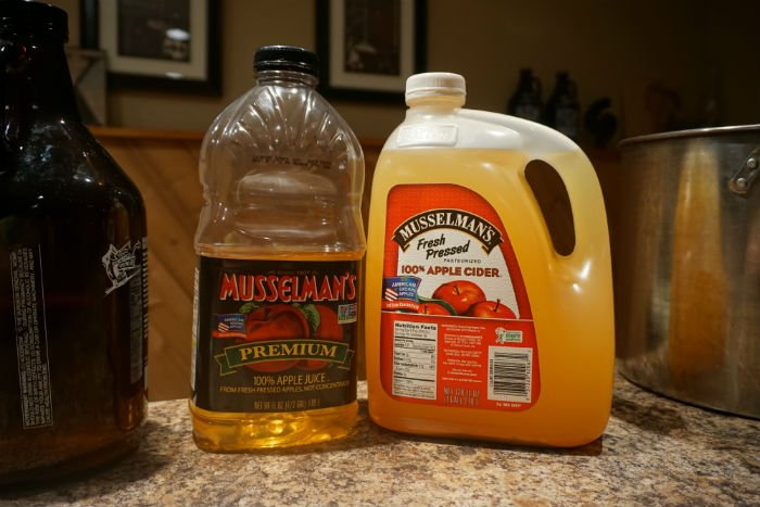 Bottles of apple juice for making hard cider
